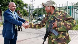 Belden Namah and wary PNGDF soldier