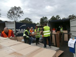 Martyn Namorong loads boxes in Brisbane