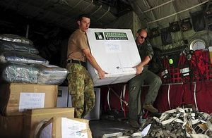 Unloading ballot boxes from a RAAF Hercules aircraft