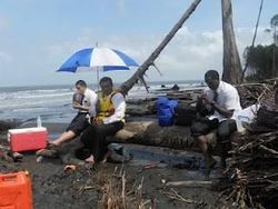 Two LDS missionaries wait for a rescue boat on Upa Ula Island