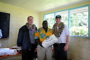 Senator Feeney (L) and Mr Marles (R) with Gibson Apusae from Kukudu village, Solomon Islands