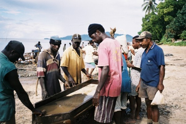 Panning gold on a beach near Loloho, Bougainville