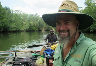 Craig Hand with village elder Gwama in the Lom River