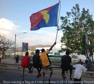 Boys waving national flag at 4 Mile