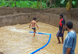 Constructing a fish pond in the highlands (F Gako)