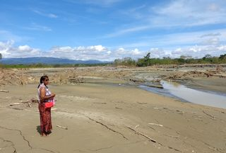 Margaret pensive and thoughtful as she ponders the destruction of the Nalibiu river