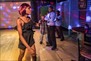 A club customer expresses his excitement as a homosexual passes him by during the Miss Gay World 2013 show at Port Moresby's Diamond nightclub