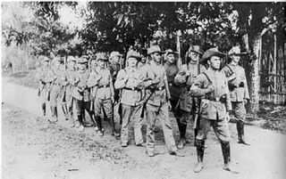 Imperial German army troops match along Bitapaka Road