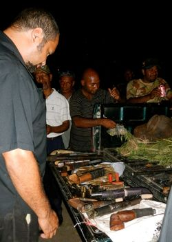 Oro Governor Gary Juffa inspects a cache of illegal weapons