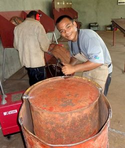 Togoniade Mervin prepares drum oven for welding