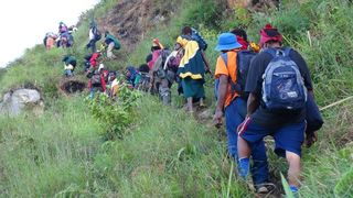 Pilgrims climb up Gena mountain near Migende