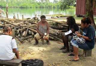DWU students interviewing a mother