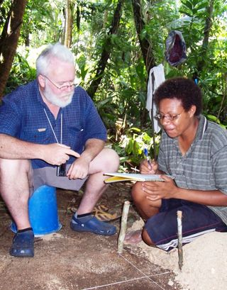 Prof Summerhayes and Loretta Hasu (UPNG) at Koil Island (Matthew Leavesley, 2006)