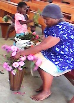 Maria arranging her flowers in church