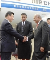 Frank Bainimarama welcomes Xi Jinping to Fiji (ABC)