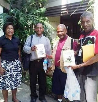 Mary Walrus, Acting National Librarian; Steven Ilave Snr, Member COG; Michael Maravila, Provincial Representative; Robert Eri, –National Aids Council Secretariat