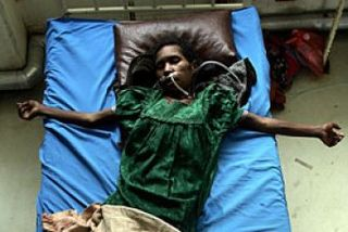 Female HIV AIDS patient in PNG (Torsten Blackwood, AFP)