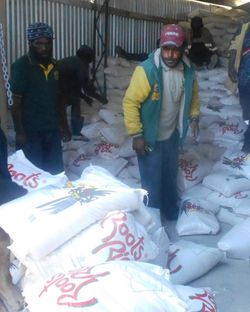 Rice bags being counted at Kandep warehouse