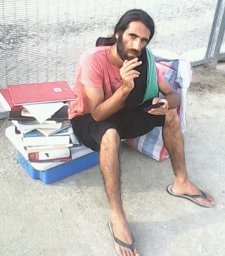 Behrouz Boochani with all his possessions