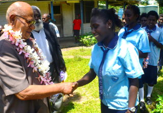 President Momis is welcomed by a student