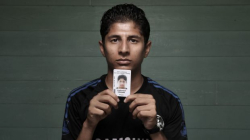 Loghman Sawari with his identify card (Andrew Meares)