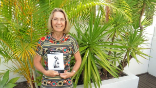 Cr Ingrid Jackson with a copy of My Walk to Equality