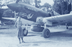 Flight Sergeant Jim Harvey (in cockpit) poses with his beloved P-40 Kittyhawk Come in Suckers! at Tadji