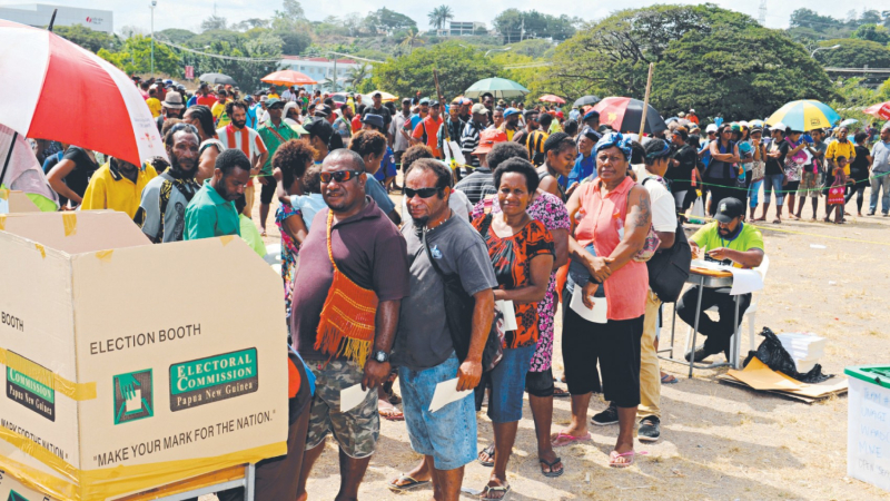 Voters queue to cast thir ballots (Post-Courier)