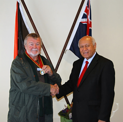 Chris Owen receives Order of Logohu medal from Sir Charles Lepani  PNG  High Commissioner to Australia  2012 (Andrew Pike)