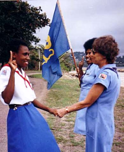 Mary Lou (right) swears in a Guide leader