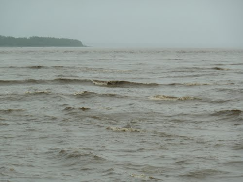 Bamu bore tide at the river mouth
