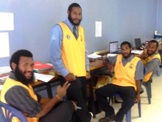 School based liaison officer (standing) with the three University of Goroka trainee teachers