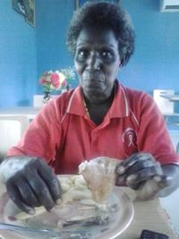 Agnes Rita Maineke celebrating her birthday with a meal of chicken & chips