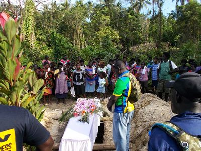Pastor Steven speaking at the funeral in Kaabaku