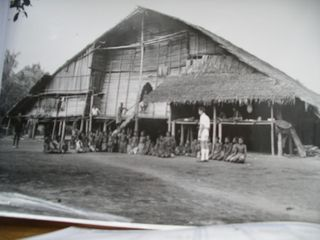 Ken in front of a Balimo long house, 1957