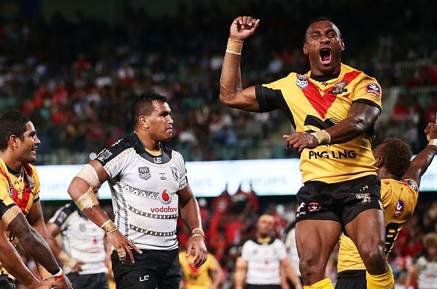 Nene Macdonald of Papua New Guinea celebrates with team mates after scoring a try (Getty Images)