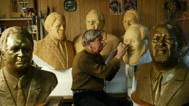 Hal Holman with busts of former PNG prime ministers (Jacky Ghossein)