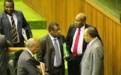Members of the Papua New Guinea government, including Treasurer Patrick Pruaitch (centre)