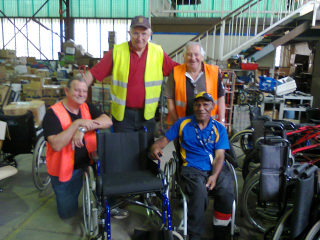 Toowong Rotary members Eddie Berkowitz, Ted Horsburgh and Murray Bladwell with Francis Nii