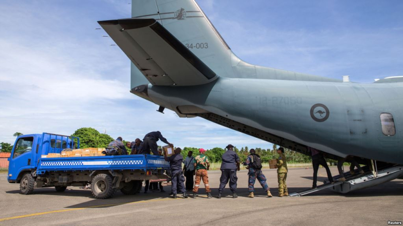 Ballot boxes unloading from Australian military aircraft