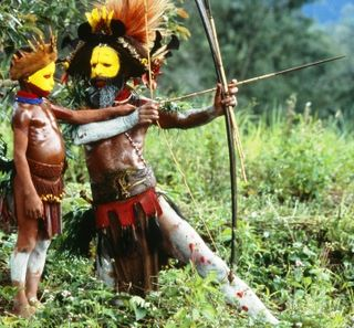 A Huli father instructs his son