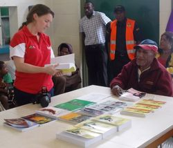 Francis Nii with books presented to Digicel