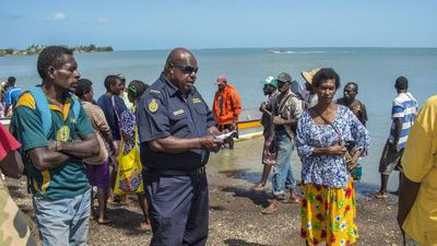Australian Border Force officer Harry Davo checks PNG nationals (Brian Cassey)