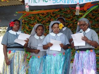 Sisters of the Hand Maids of the Lord performing a tribute song to the missionaries