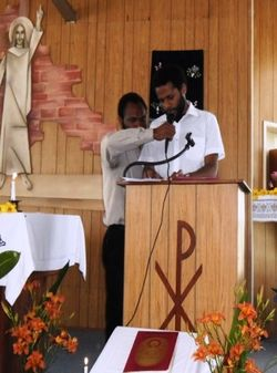 Emmanuel takes the 1st Reading during the Grade 12 thanksgiving mass