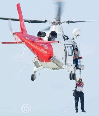 A marine pilot being transferred to a cruise ship by helicopter off Durban