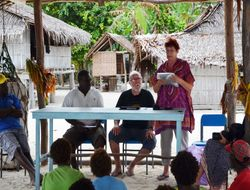 Marian speaking to villagers about the story of Peter