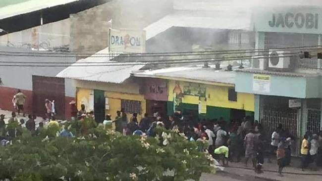Looting amidst riots in Port Moresby