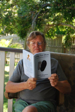 Phil with Diddie Jackson's book of poetry