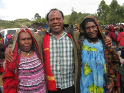 Cr Paul Kurai with two elderly local women